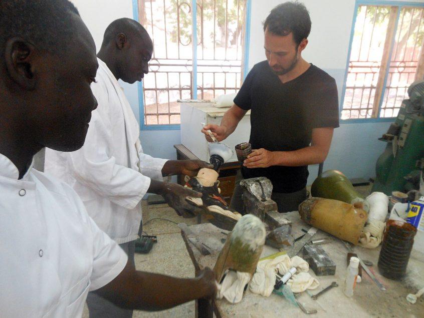 men working on Prosthetic legs