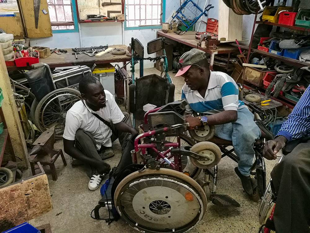 amputees fixing wheelchair